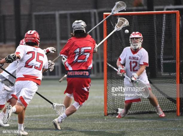 Northern defender Jake Purcell shoots on gaol against Glenelg goalie Brian Doughty during the Maryland State 3A/2A lacrosse championship game on May...