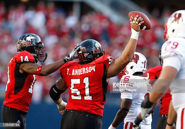 Northern Illinois defensive lineman Zach Anderson celebrates an interception with teammate Courtney Stephen during the fourth quarter against...