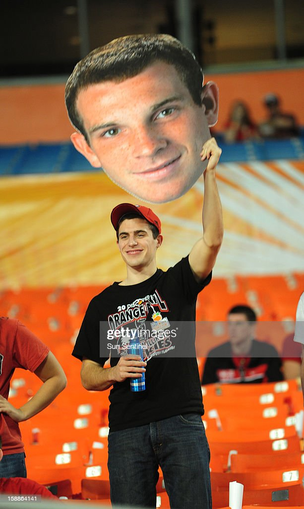 A Northern Illinois fan holds a giant photo of the team's quarterback Jordan Lynch before the Orange Bowl game against Florida State on Tuesday, January 1, 2013, in Miami Gardens, Florida.