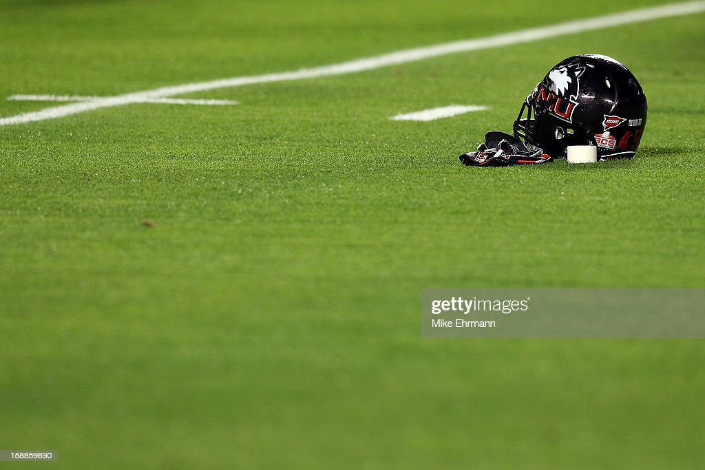 A Northern Illinois Huskies helmet is seen on the field against the Florida State Seminoles during the Discover Orange Bowl at Sun Life Stadium on January 1, 2013 in Miami Gardens, Florida.