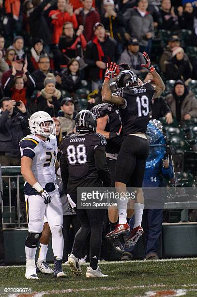 Northern Illinois Huskies tight end Shane Wimann and Northern Illinois Huskies wide receiver Kenny Golladay celebrate a Wimann touchdown in the 1st...
