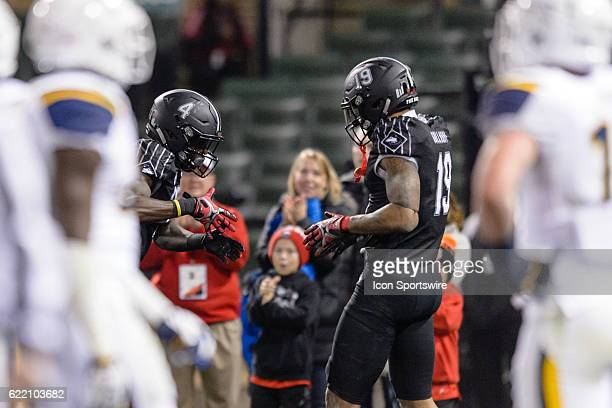 Northern Illinois Huskies wide receiver Christian Blake and Northern Illinois Huskies wide receiver Kenny Golladay celebrate a Blake touchdown...