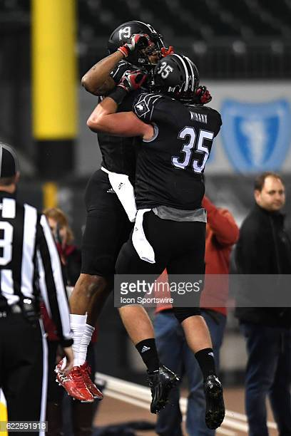 Northern Illinois Huskies wide receiver Kenny Golladay celebrates a touchdown with Northern Illinois Huskies tight end Shane Wimann in the first half...