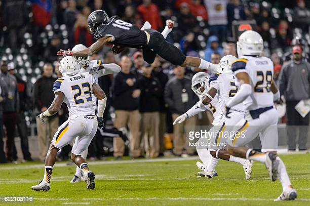 Northern Illinois Huskies wide receiver Kenny Golladay goes airborne after a reception in the 4th quarter during a MidAmerican Conference football...