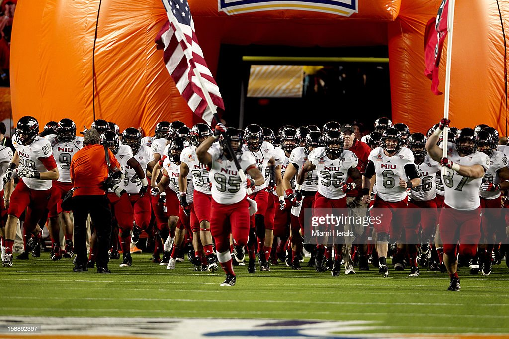 Northern Illinois takes the field before the Discover Orange Bowl game against Florida State on Tuesday, January 1, 2013, in Miami Gardens, Florida.