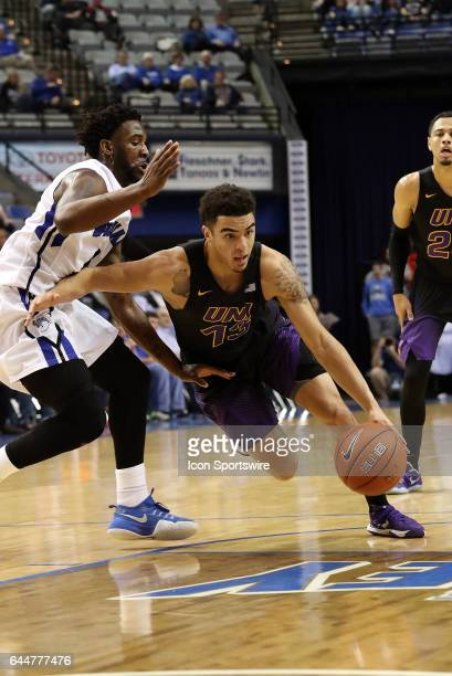 Northern Iowa Panthers guard Juwan McCloud dribbles by Indiana State Sycamores guard Everett Clemons during the Missouri Valley Conference game on...