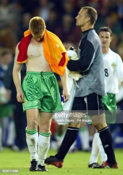 Northern Ireland captain Steve Lomas leaves the field after his team was beaten 30 by Spain in their 2004 European championship group game at The...