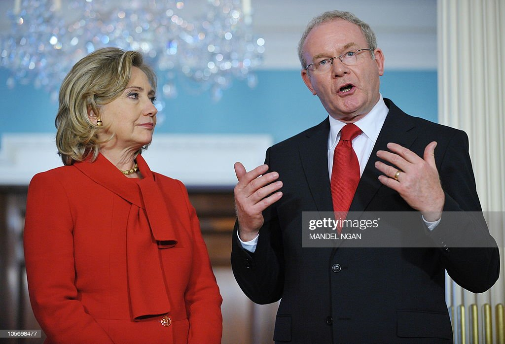 Northern Ireland Deputy First Minister Martin McGuiness (R) speaks as US Secretary of State <a gi-track='captionPersonalityLinkClicked' href=/galleries/search?phrase=Hillary+Clinton&family=editorial&specificpeople=76480 ng-click='$event.stopPropagation()'>Hillary Clinton</a>(C) looks on ahead of a meeting October 19, 2010 at the State Department in Washington, DC. AFP PHOTO/Mandel NGAN