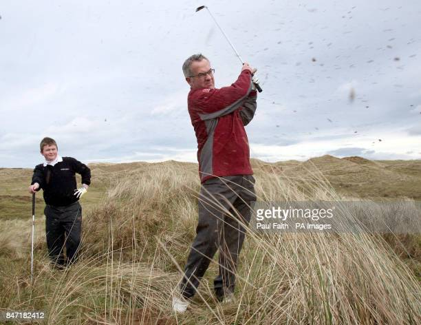 Northern Ireland Environment minister Alex Attwood plays golf on the site of the proposed new Bushmills Dunes golf course with Irish under 14 team...