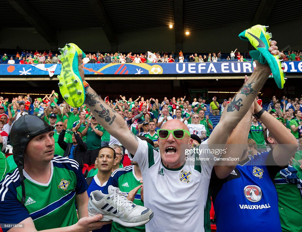 A Northern Ireland fan celebrates after being given the boots of Northern Ireland's Stuart Dallas during the UEFA Euro 2016 Round of 16 match between Wales and Northern Ireland at Parc des Princes on June 25 in Paris, France.