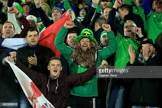 Northern Ireland fans celebrate after the UEFA EURO 2016 Qualifying match between Finland and Northern Ireland at the Olympic Stadium on October 11...