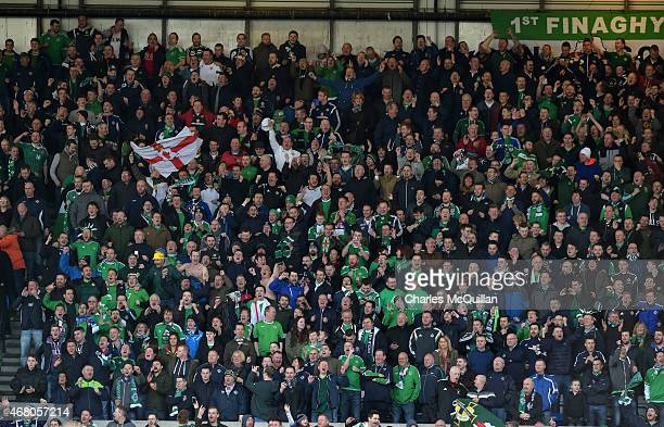 Northern Ireland fans celebrate during the EURO 2016 Group F qualifier between Northern Ireland and Finland at Windsor Park on March 29 2015 in...