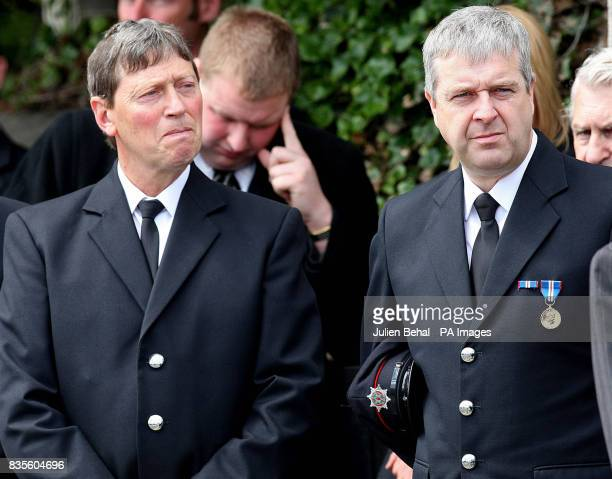 Northern Ireland firemen attend the funeral of Pilot and retired Police Officer Hugh McKnight at the Annalong Presbyterian church Dublin