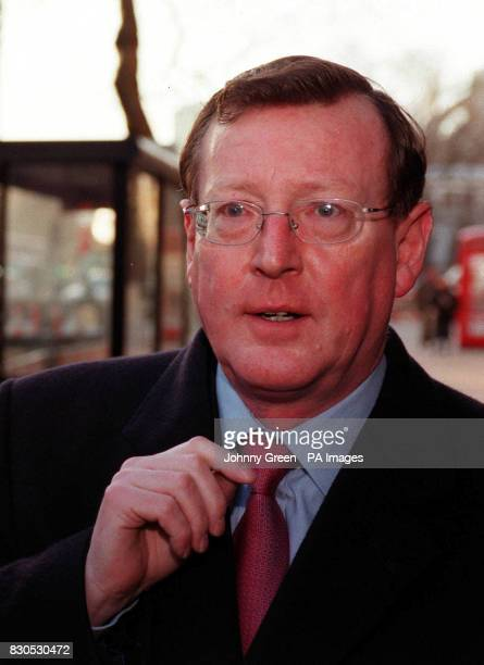 Northern Ireland First Minister David Trimble arrives at the Treasury in central London for talks with British Chancellor of the Exchequer Gordon...