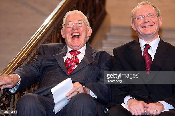 Northern Ireland First Minister Ian Paisley left and Martin McGuinness deputy first minister share a joke at Stormont in Belfast UK Tuesday May 8...