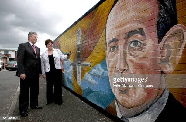 Northern Ireland First Minister Peter Robinson and Dawn Pavis Progressive Unionist Party MLA officially unveil the new CS Lewis mural in Dee Street...