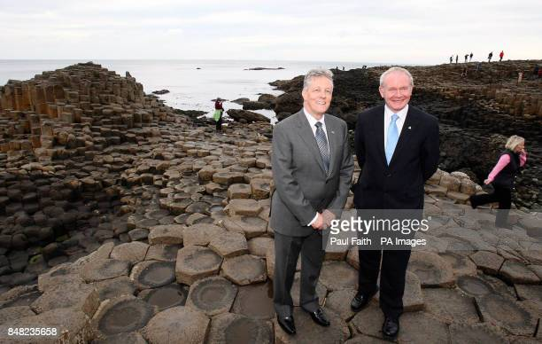 Northern Ireland First Peter Robinson and Deputy First Minister Martin McGuinness on the stones at the Giant's Causeway in County Antrim after the...
