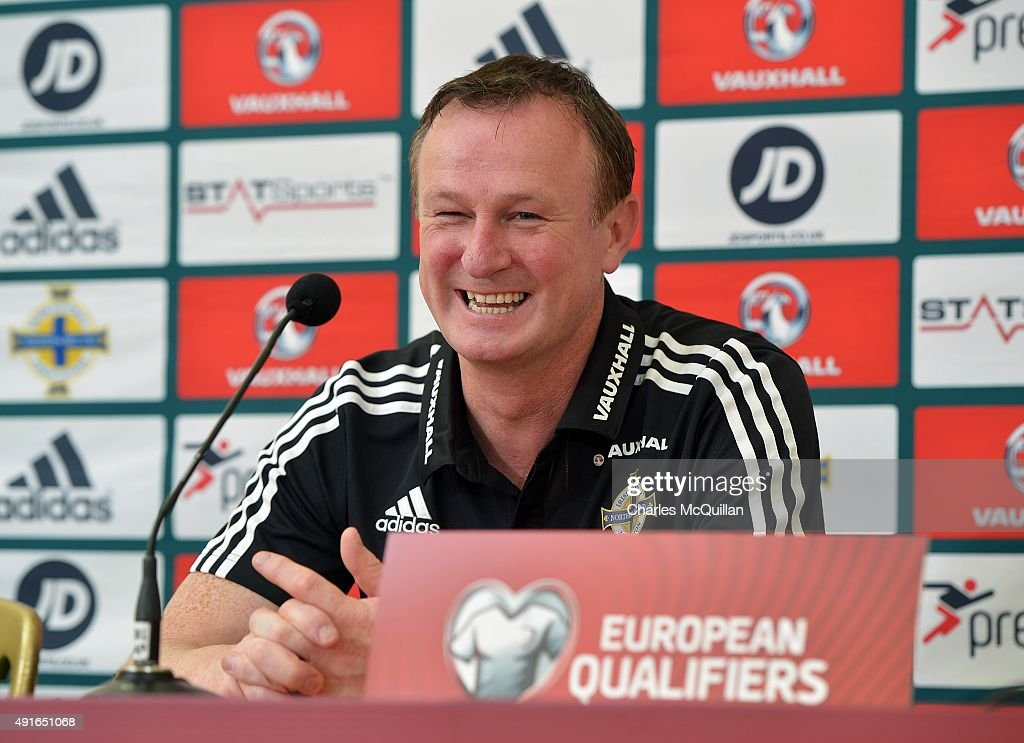 Northern Ireland football manager Michael O'Neill laughs with journalists as he holds a press conference at Windsor Park on October 7, 2015 in Belfast, Northern Ireland. Northern Ireland host Greece in a Euro 2016 Group F game at Windsor Park on Thursday evening.