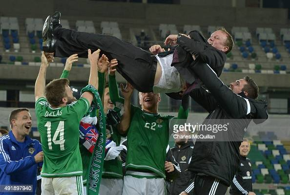 Northern Ireland manager Michael O'Neill is thrown in to the air by his players as they celebrate clinching qualification after this evenings Euro...