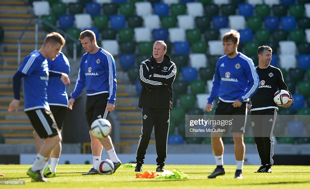 Northern Ireland manager Michael O'Neill (3rd L) shouts instuctions as the international football squad train at Windsor Park on October 7, 2015 in Belfast, Northern Ireland. Northern Ireland host Greece in a Euro 2016 Group F game at Windsor Park on Thursday evening.