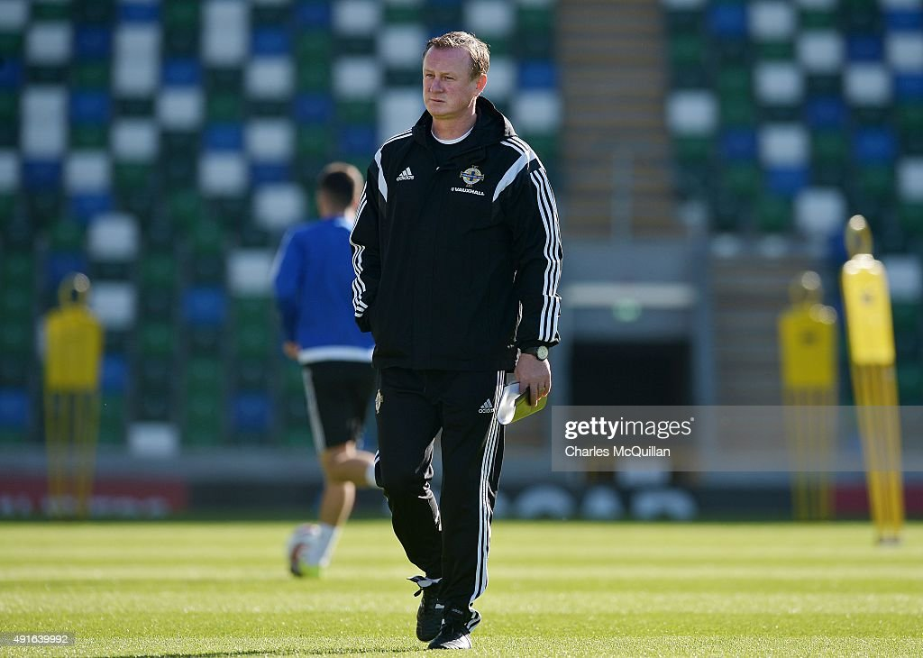 Northern Ireland manager Michael O'Neill watches on as the international football squad train at Windsor Park on October 7, 2015 in Belfast, Northern Ireland. Northern Ireland host Greece in a Euro 2016 Group F game at Windsor Park on Thursday evening.