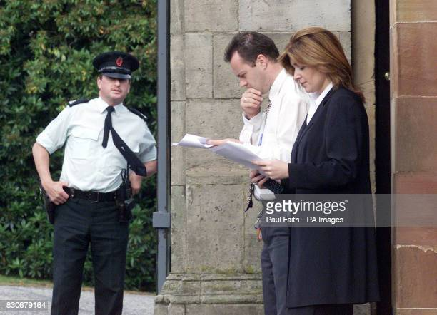 Northern Ireland officals at the gates of Hillsborough Castle Belfast read the proposals put forward to break the deadlock in the Good Friday...