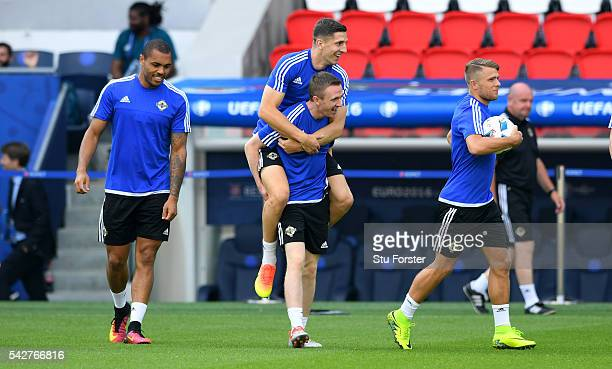 Northern Ireland player Shane Ferguson gives Craig Cathcart a ride before Northern Ireland training ahead of their Euro 2016 match against Wales at...