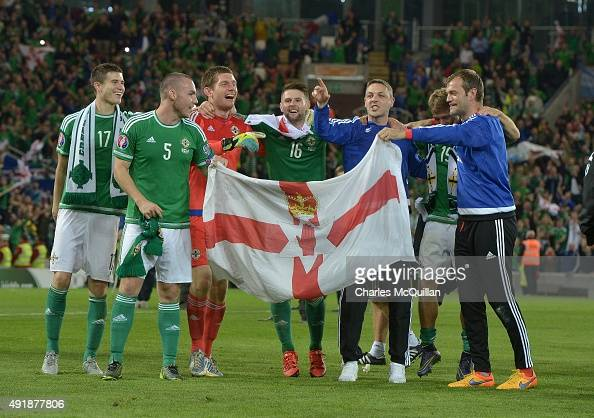 Northern Ireland players celebrate clinching qualification after the UEFA EURO 2016 qualifier between Northern Ireland and Greece at Windsor Park on...