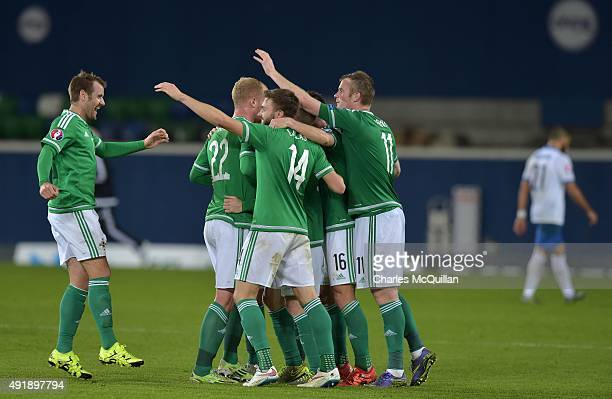Northern Ireland players celebrate clinching qualification after this evenings Euro 2016 Group F international football match against Greece at...