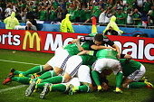 Northern Ireland players celebrate their first goal during the UEFA EURO 2016 Group C match between Ukraine and Northern Ireland at Stade des...