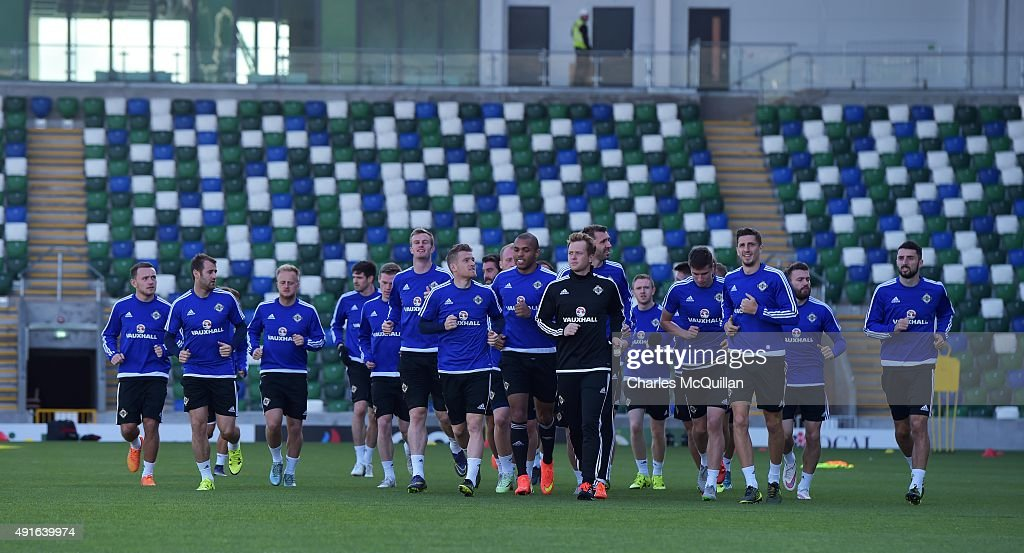 Northern Ireland players warm up with a jog around the pitch as the international football squad train at Windsor Park on October 7, 2015 in Belfast, Northern Ireland. Northern Ireland host Greece in a Euro 2016 Group F game at Windsor Park on Thursday evening.