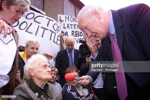 Northern Ireland Secretary Dr John Reid meets 83yearold Annie Blair the oldest resident of riot torn Cluan place in East Belfast Mr Reid met...