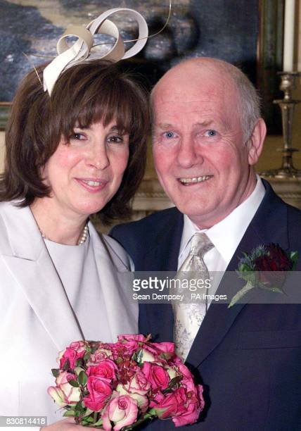 Northern Ireland Secretary Dr John Reid with his Brazilianborn wife Carine Adler after the couple was married in central London His wedding ceremony...