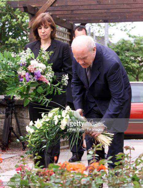 Northern Ireland Secretary of State Dr John Reid joined by his parther Carine Adler on his first visit to the town laying flowers in the Remembrance...