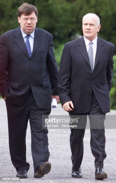 Northern Ireland secretary of State John Reid arrives at Hillsborough Castle Belfast with Irish Foreign Affairs Minister Brian Cowan on the day the...