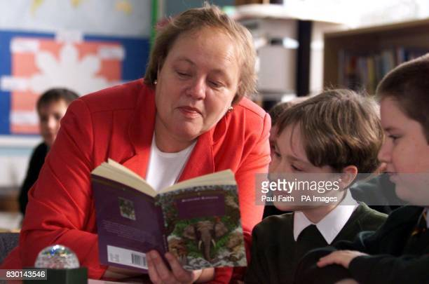 Northern Ireland Secretary of State Mo Mowlam reads to pupils in the Primary Seven class at Dundonald Primary School during a visit to promote the...