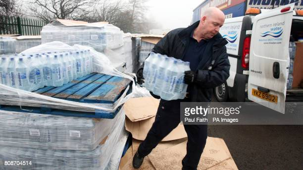 A Northern Ireland Water employee unloads bottled water supplied by the Scottish government in BelfastPicture date Thursday December 30 2010...