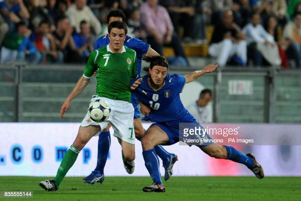 Northern Ireland's Andrew Little in action with Italy's Corry Evans during the International Friendly at the Arena Garibaldi Stadium Pisa Italy