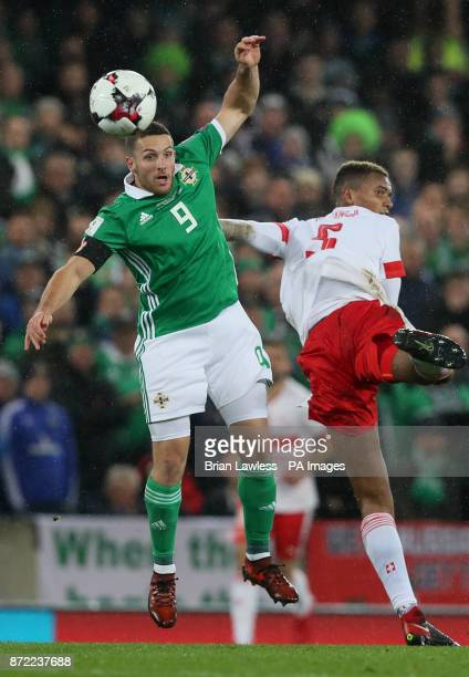 Northern Ireland's Conor Washington and Switzerland's Manuel Akanji battle for the ball during the 2018 World Cup Qualifying PlayOff First Leg match...