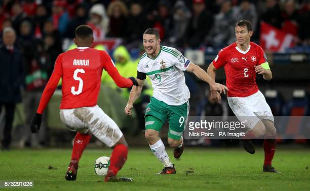 Northern Ireland's Conor Washington battles with Switzerland's Manuel Akanji and Stephan Lichtsteiner during the FIFA World Cup Qualifying second leg...
