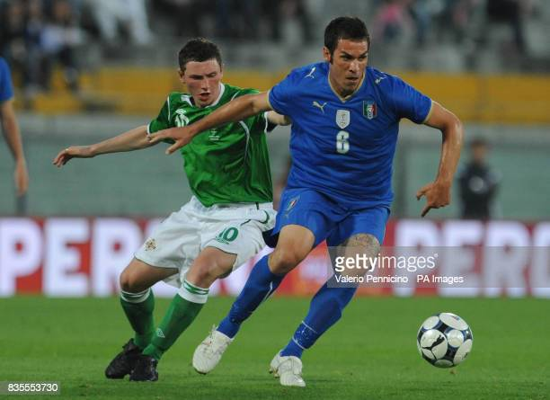 Northern Ireland's Corry Evans in action with Italy's Gaetano D'Agostino during the International Friendly at the Arena Garibaldi Stadium Pisa Italy