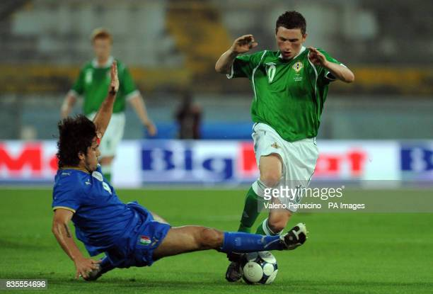 Northern Ireland's Corry Evans skips over a challenge from Italy's Gennaro Gattuso during the International Friendly at the Arena Garibaldi Stadium...