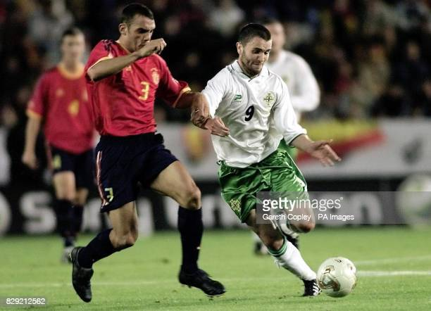 Northern Ireland's Damian Johnson and Spain's Raul Bravo in action during their European Championship Qualifying Group 6 match at the Carlos Belmonte...