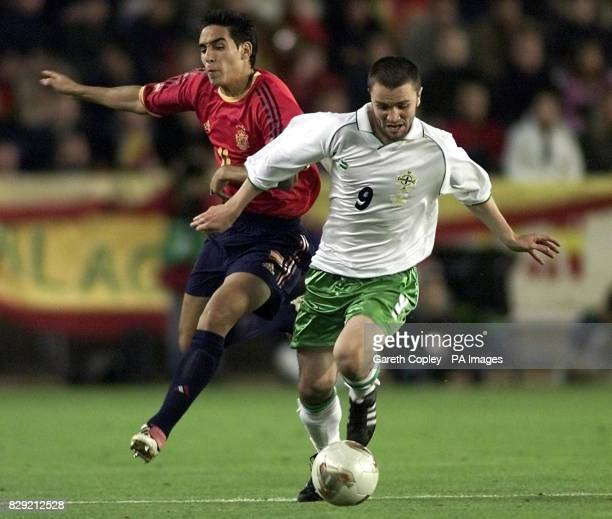 Northern Ireland's Damien Johnson gets past Spain's Vicente during their European Championship Qualifying Group 6 match at the Carlos Belmonte...