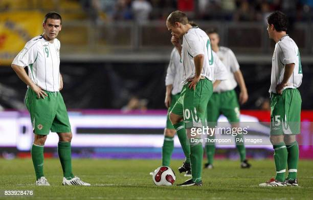 Northern Ireland's David Healy and Warren Feeney appear dejected as they wait to kick off following a goal by Spain's Hernandez Xavi during the UEFA...
