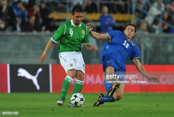 Northern Ireland's David Healy in action with Italy's Riccardo Montolivo during the International Friendly at the Arena Garibaldi Stadium Pisa Italy