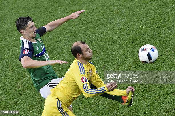 Northern Ireland's defender Aaron Hughes vies with Ukraine's forward Roman Zozulya during the Euro 2016 group C football match between Ukraine and...