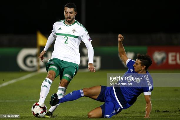 Northern Ireland's defender Conor McLaughlin fights for the ball with San Marino's midfielder Michael Battistini during the 2018 FIFA World Cup...