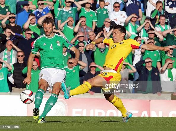 Northern Ireland's defender Gareth McAuley vies with Romania's forward Claudiu Keseru during the Euro 2016 qualifying Group F football match between...