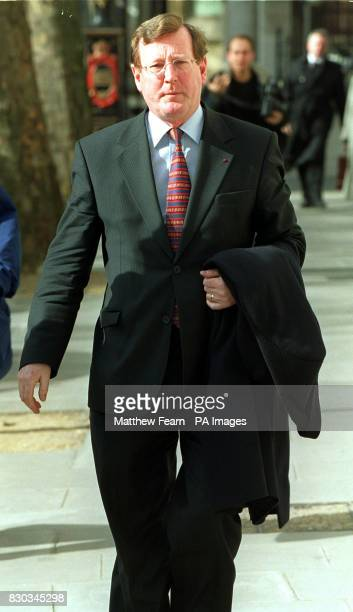 Northern Ireland's First Minister David Trimble arrives at the High Court in London to give evidence for The Sunday Times newspaper in its defence to...